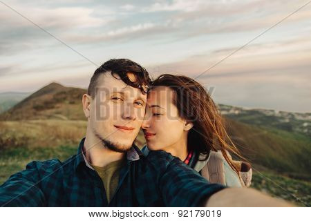 Couple Taking Self-portrait Outdoor