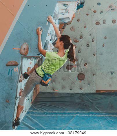 Sportswoman Climbing Indoor