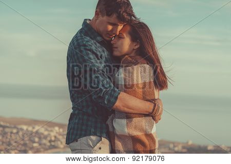 Man Embraces A Woman Outdoor
