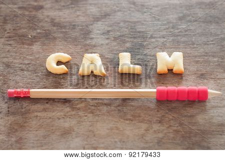 Calm Alphabet Biscuit On Wooden Table