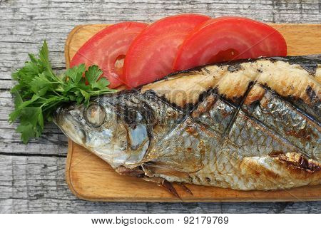 Herring, Grilled, Sliced Tomato And Parsley On A Cutting Boards Closeup
