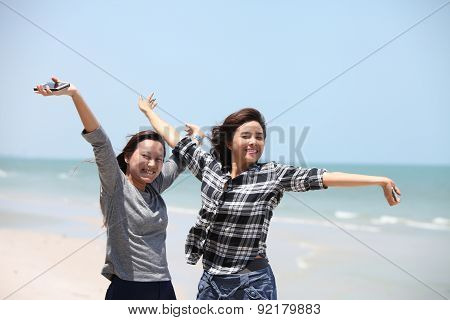 Two Woman Feel Happy On The Beach