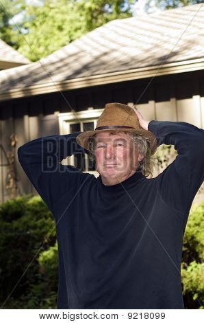 Middle Age Senior Man With Fashionable Hat In Yard
