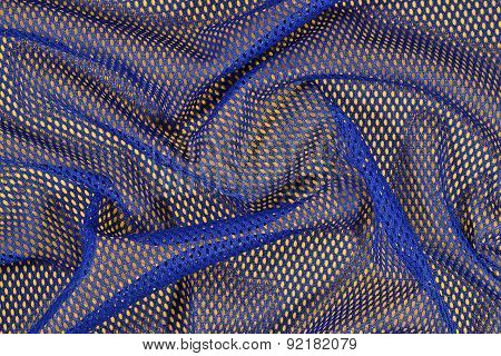 Blue Crumpled Nonwoven Fabric On A Yellow