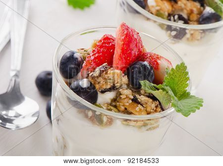 Granola With Yogurt And Berries In Glasses.