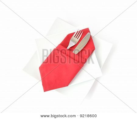 Knife And Fork In A Red Napkin