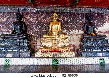 Golden and black Buddha statue