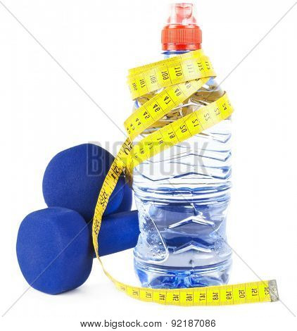 Two dumbells, water in bottle  on white background