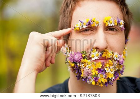 Hipster Face-covered With Flowers Thinking