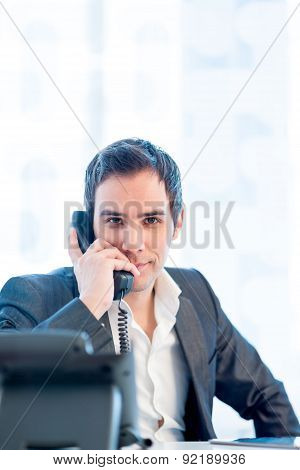 Young Businessman Talking On Phone At The Office