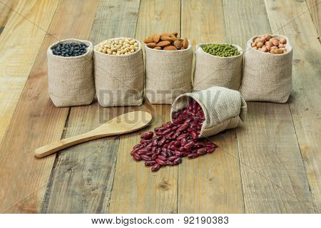 Different Kinds Of Beans In Sacks Bag, Focus On  Scattered Kidney Beans