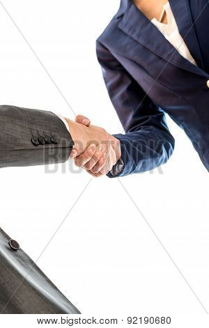 Businesspeople Shaking Hands To Close A Business Deal