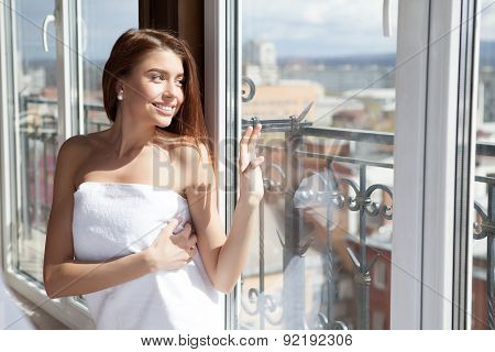 Young Beautiful Woman Enjoying Her Morning Near Big Window