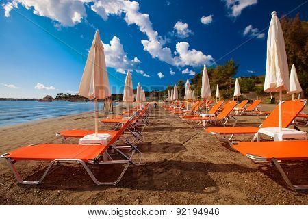travel concept - sunchairs with  umbrellas on beautiful  beach, Zakynthos  island, Greece