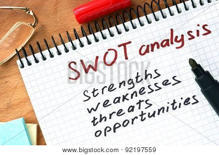 Notepad with  SWOT analysis concept