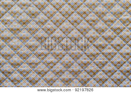 Lilac Quilted Fabric With A Brown Crosses