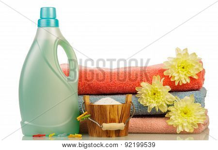 Detergent in bottle and towels
