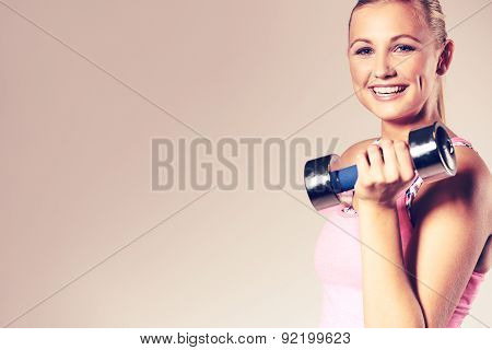 Woman Smiling At Camera And Holding Dumbbell.