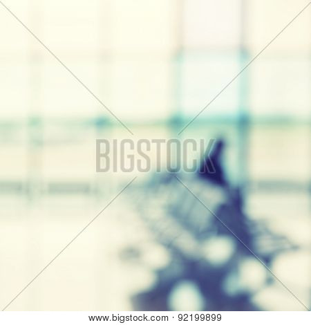 Passenger in the airport lounge - defocused background. Instagram style filtred image