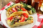 foto of tacos  - Mexican food Tacos in plate on napkin - JPG