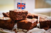 stock photo of brownie  - Chocolate brownies with a Union jack flag - JPG