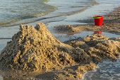 picture of yellow castle  - Sand castle destroyed and forgotten children - JPG