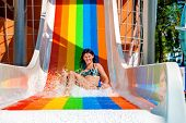 pic of mattress  - Happy woman  swimming on inflatable beach mattress and showing thumb up - JPG