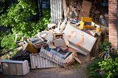 pic of junk-yard  - Funny broken furnitures trash pile at yard - JPG