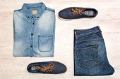 stock photo of no clothes  - many jean clothes and shoes on wood background - JPG