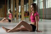 pic of pole dancing  - Girl sitting on the floor in pole dance class - JPG