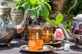 stock photo of arabian  - Arabian mint tea served in the summer garden - JPG