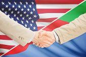 stock photo of eritrea  - Businessmen shaking hands  - JPG
