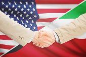 stock photo of kuwait  - Businessmen shaking hands  - JPG