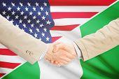 stock photo of nigeria  - Businessmen shaking hands  - JPG