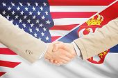 picture of serbia  - Businessmen shaking hands  - JPG