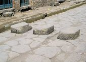 picture of stepping stones  - three stepping stones on a street in old pompei - JPG