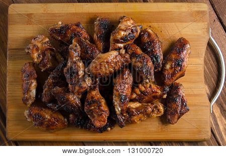 grilled chicken wings on the wooden table