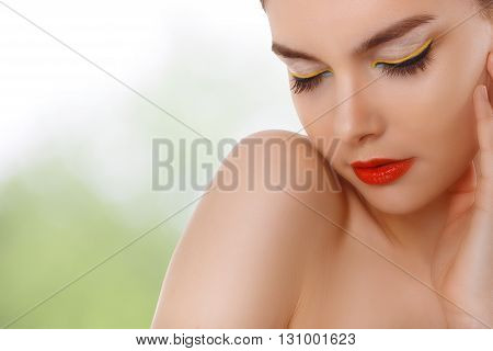 closeup portrait of a beautiful woman with beauty face and clean face skin , glamour makeup. Green background. Makeup consept for cosmetics advertising.