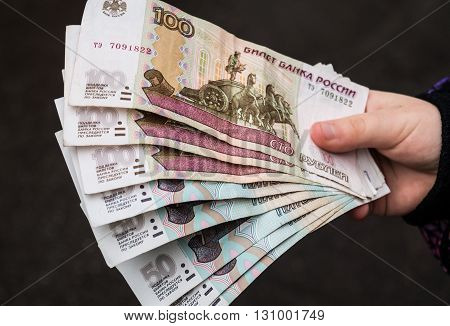 Russian money rubles in hand close up