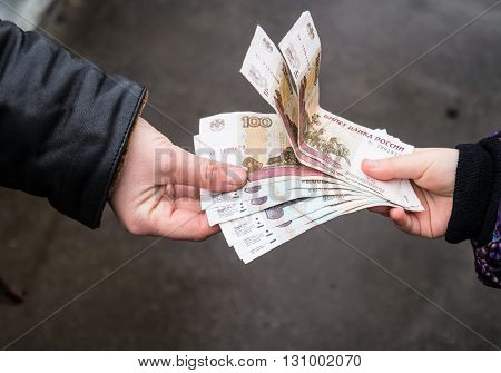 The transfer of money from hand to hand