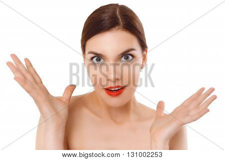Young surprised cute woman on white background. Makeup consept for cosmetics advertising.
