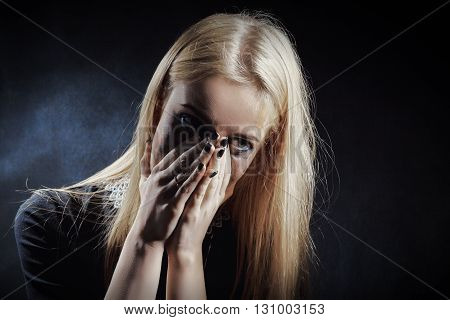 sad shocked girl crying on black background