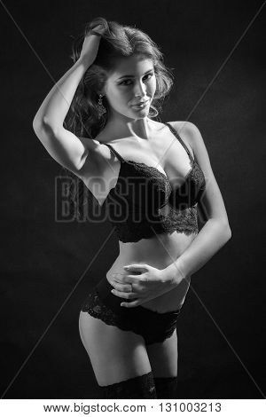 beautiful woman show her slim body monochrome image