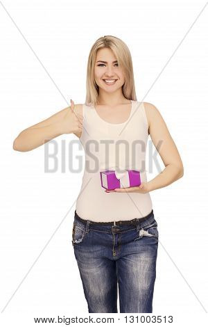 Young woman portrait holding gift and showing thumbs up