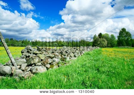 Stone Fence Separating Farm Grounds