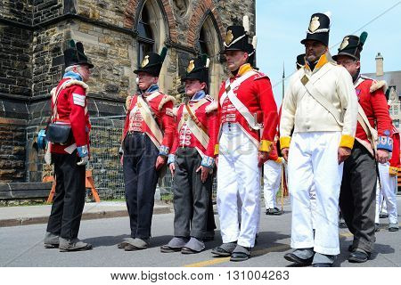 Ottawa Canada - May 21 2016: Man dressed like soldiers from 19th century near 1812 war monument circling Parliament Hill in Ottawa Canada