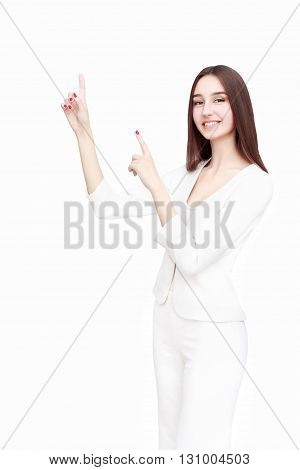 Happy young woman isolated showing something on white background