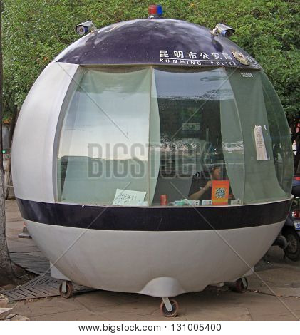 Police Officer Is Working In Portable Station, Kunming, China