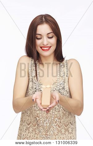 Young woman portrait holding tiny box or gift