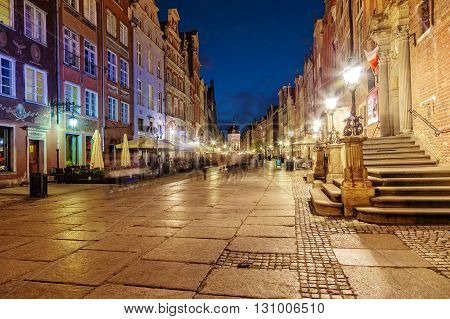 GDANSK, POLAND - MAY 05, 2016: Street scene with renaissance building of the former Town Hall in Gdansk. Old Town in Gdansk is a tourist attraction for visitors.